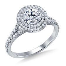 Round brilliant diamond engagement ring with halo setting