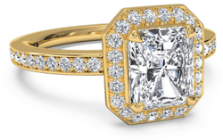 gold halo engagement ring with cushion cut diamond