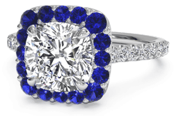 Cushion cut platinum engagement ring with sapphire halo setting