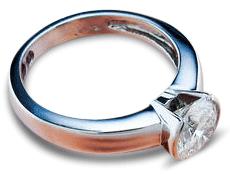 Half bezel platinum engagement ring with round brilliant solitaire diamond