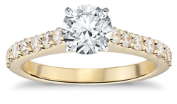 solitaire diamond engagement ring with pave yellow gold setting