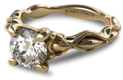 vintage gold diamond solitaire engagement ring with sculpted shank