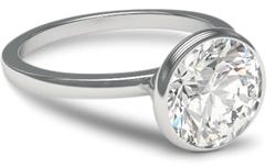 Bezel engagement ring with platinum setting