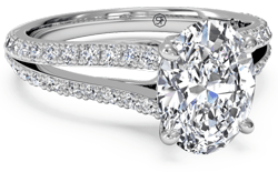 split shank engagement ring with platinum setting and oval solitiare diamond