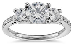 Three stone diamond engagement ring with pave setting