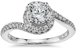 Diamond engagement ring with spiral halo setting