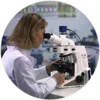 gemologist examining diamond under miroscope