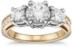 Three stone diamond engagement ring in yellow gold