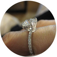 Pave engagement ring on finger