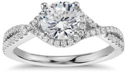 Diamond engagement ring with twisted halo setting