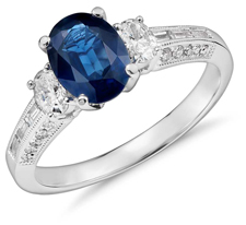 Oval sapphire engagement ring with diamond side stones
