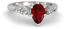 Pear ruby engagement ring with pear side stones