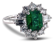 Vintage halo emerald engagement ring with diamond baguette side stones