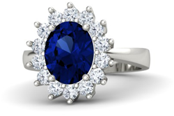 Oval sapphire engagement ring with diamond halo
