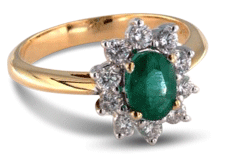 Halo emerald engagement ring with yellow gold band