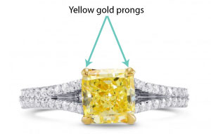 white gold engagement ring setting with yellow gold prongs and yellow diamond