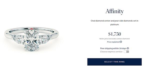 Oval Diamond center and Pear Side Diamonds set in platinum