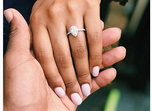 pear diamond engagement ring on hand