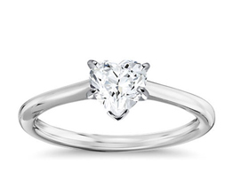 Petit heart shaped solitaire engagement ring