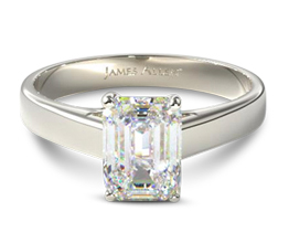 Cross prong solitaire emerald engagement ring