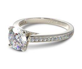Slim channel set round diamond engagement ring