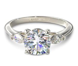 Three stone diamond engagement ring with marquise side stones