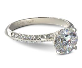 Knife edge two row pavé round diamond engagement ring