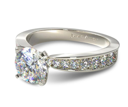 Perfect pavé graduated diamond engagement ring with 0.24 carats of side stones