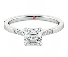 Lissome Asscher diamond centre and pavé diamond ring