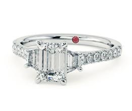 'Felicity' emerald three stone diamond ring with trapezoid side stones