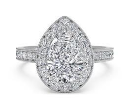 Vintage Halo Diamond Engagement Ring With Surprise Diamonds